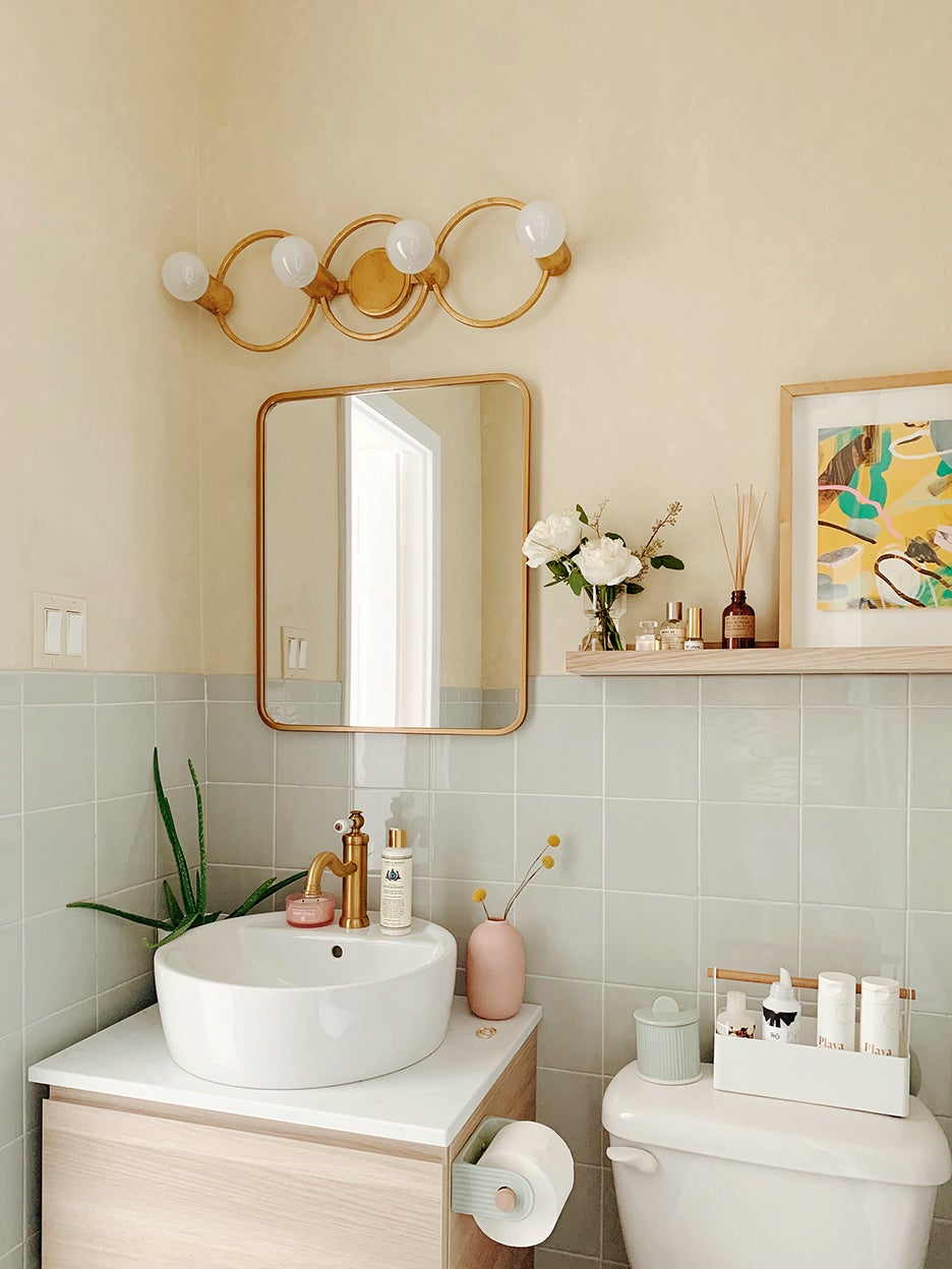 tiny bathroom with green tile walls