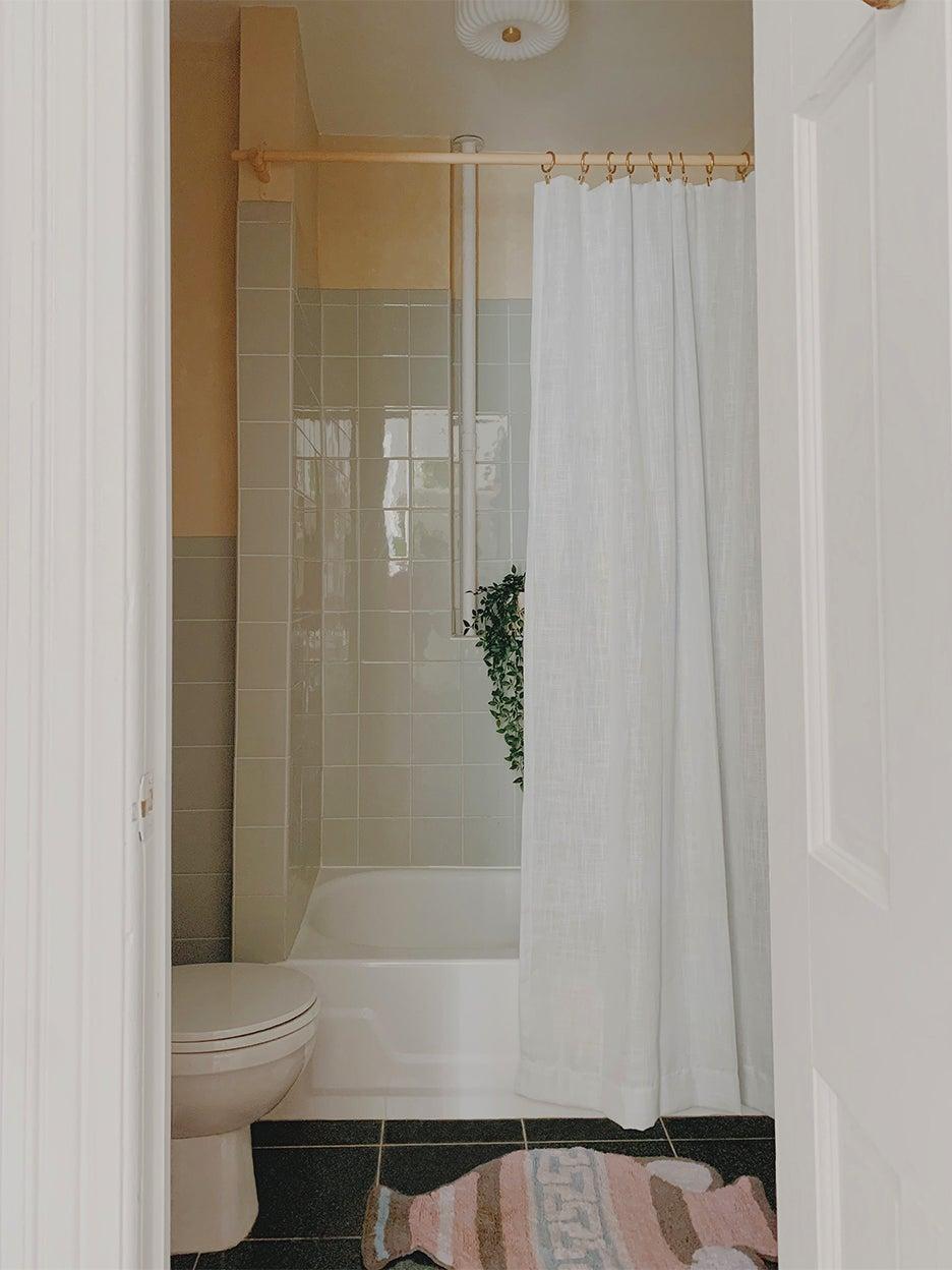 tiny bathroom with shower curtain