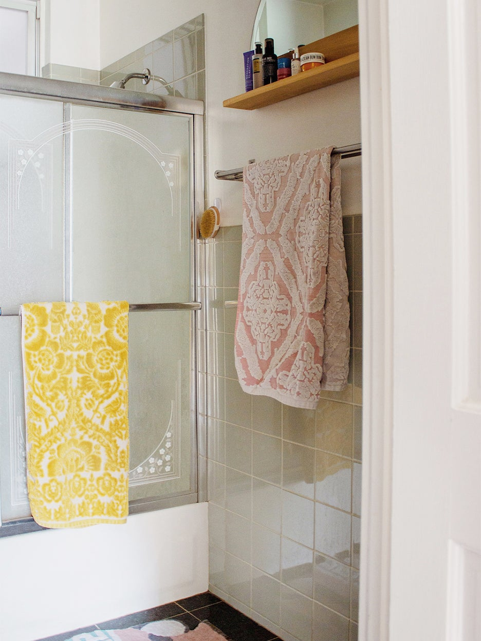 tub with glass shower door
