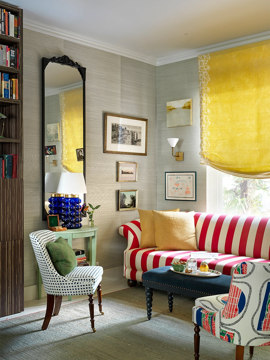 striped red couch in living room