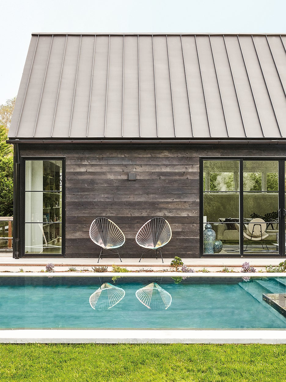 Contemporary black shou sugi ban home with pool