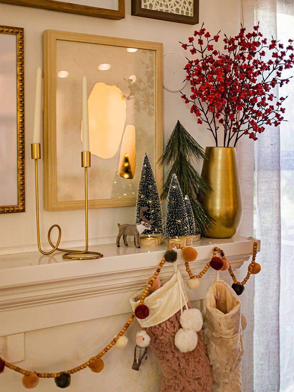 Holiday mantel with pom pom garland