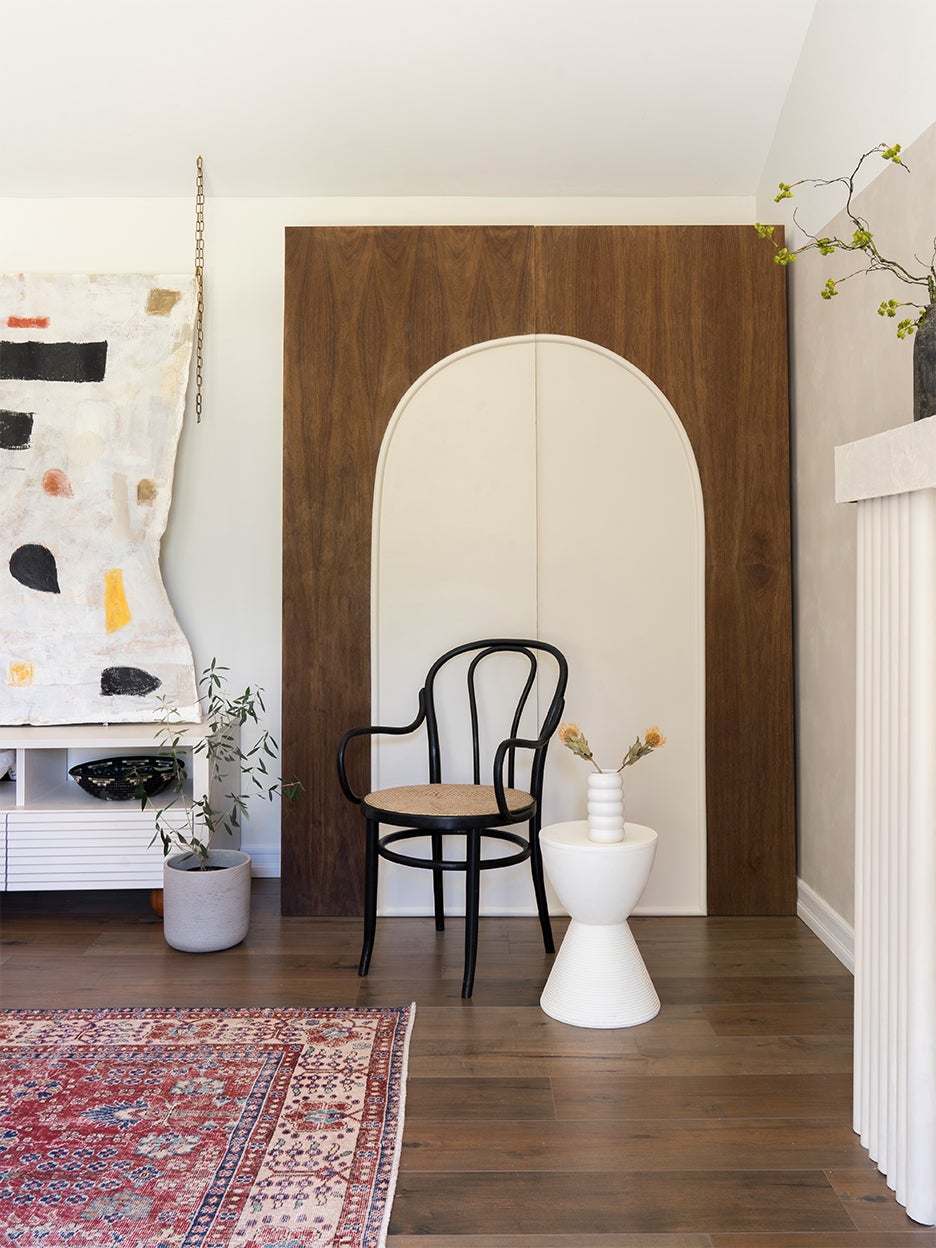 brown cabinet with white arch doors