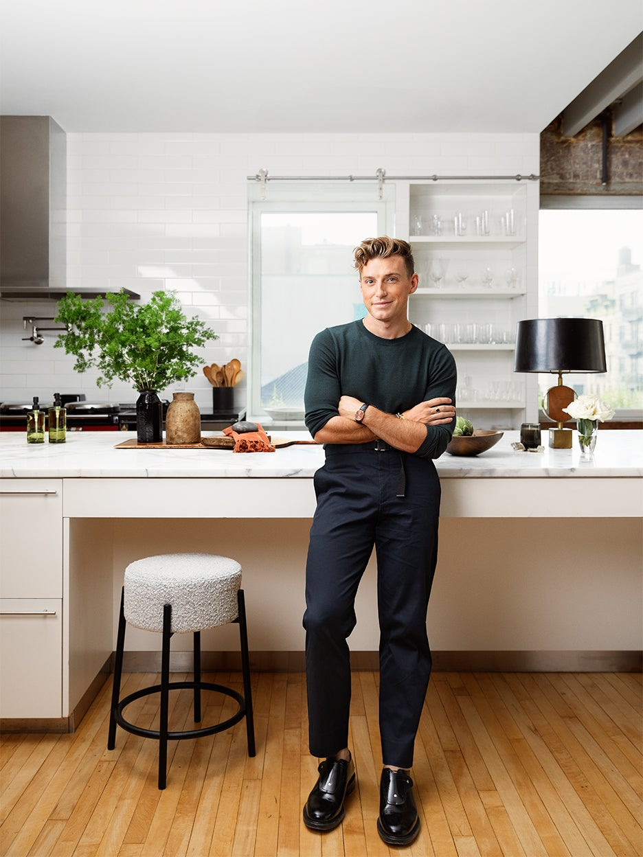 man leaning on counter