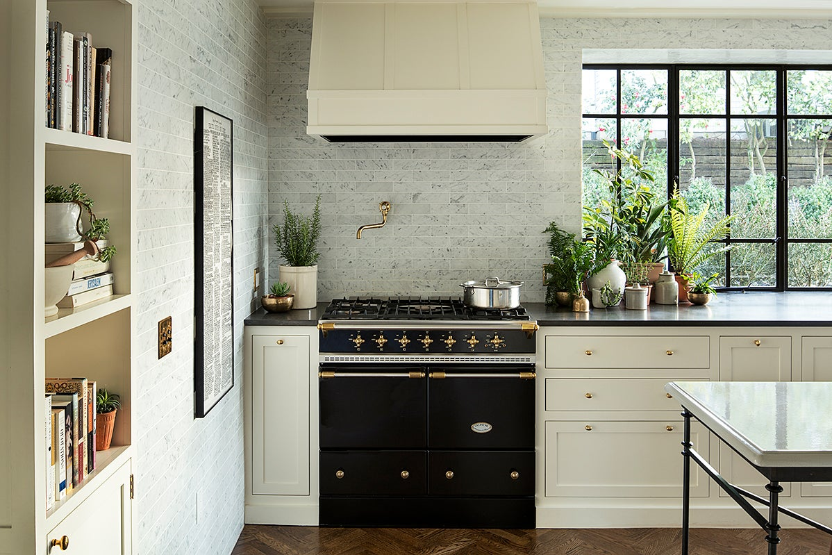 white kitchen with black stove
