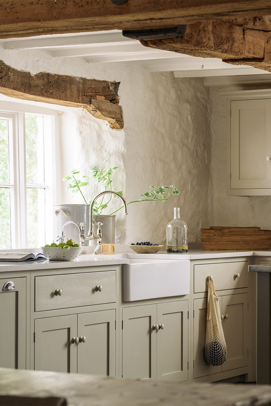 tan kitchen with wood beam ceiling