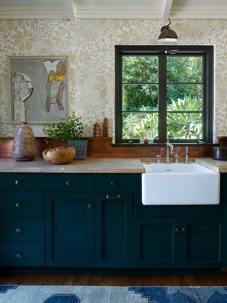 dark kitchen with farmhouse sink