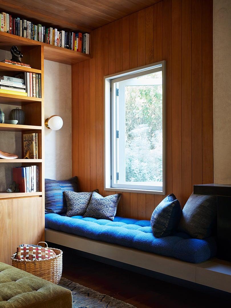 Window seat with blue seat cushion