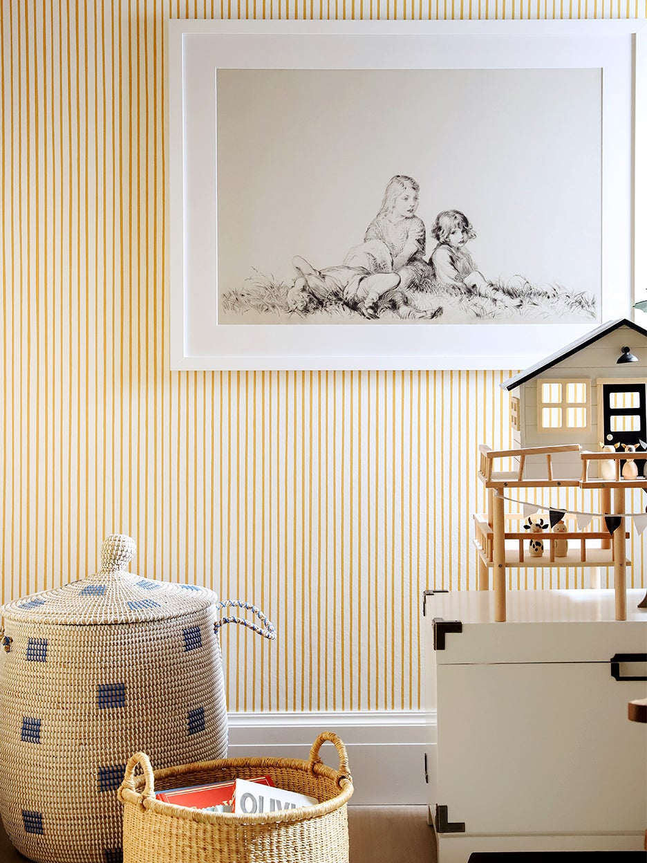 Yellow playroom with striped wallpaper