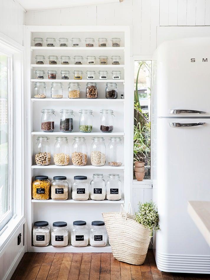 glass jars on open shelves