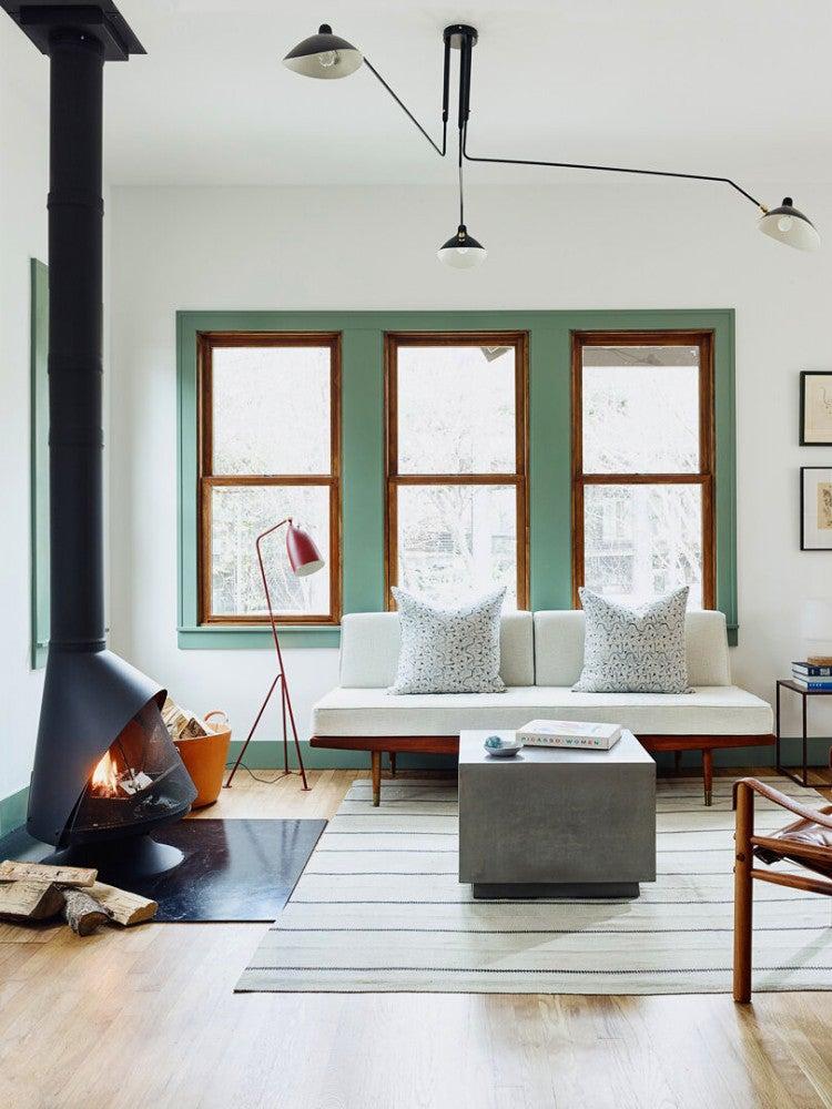 mod livign room with green window trim