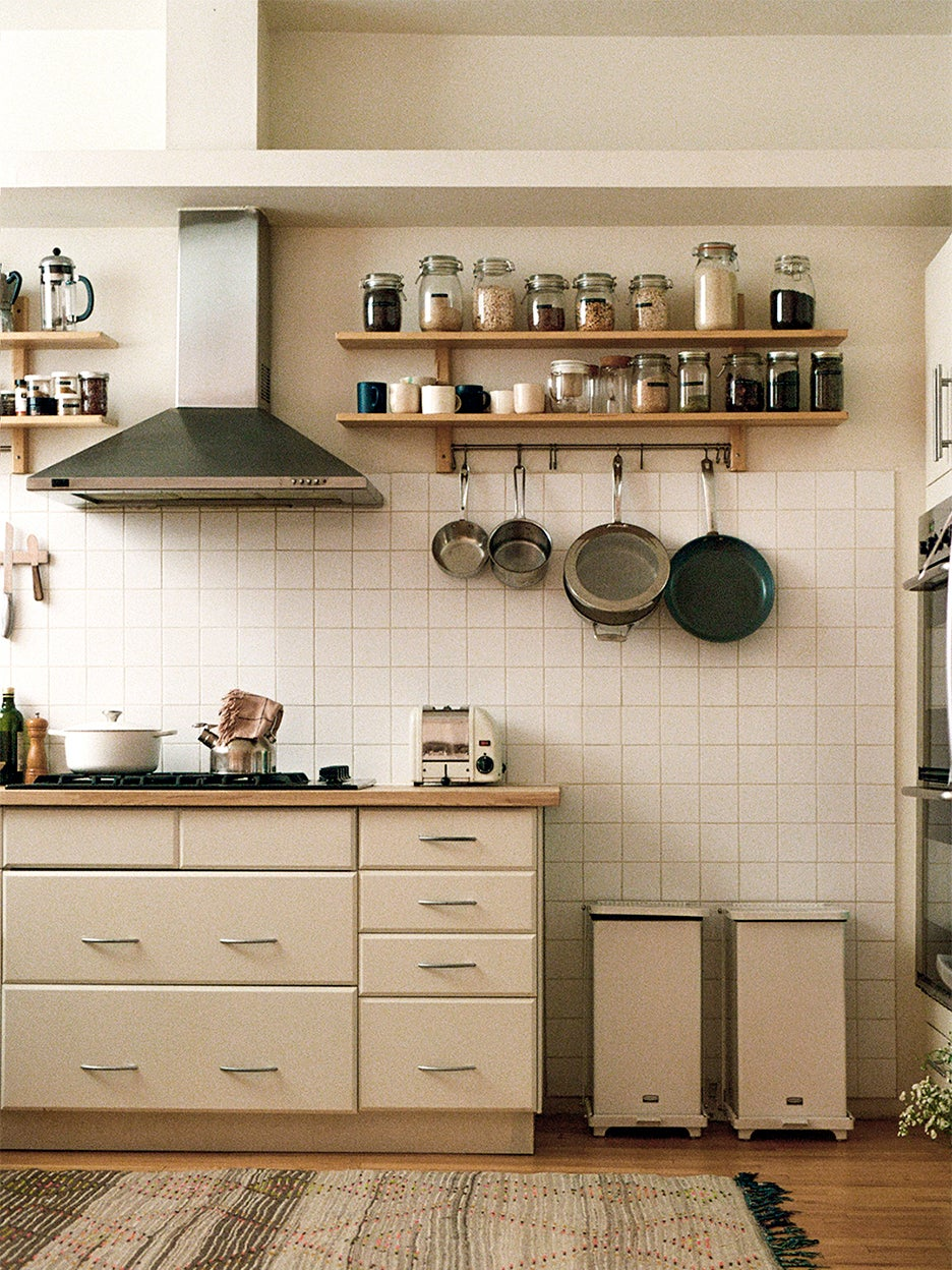 begie kitchen with exposed shelves