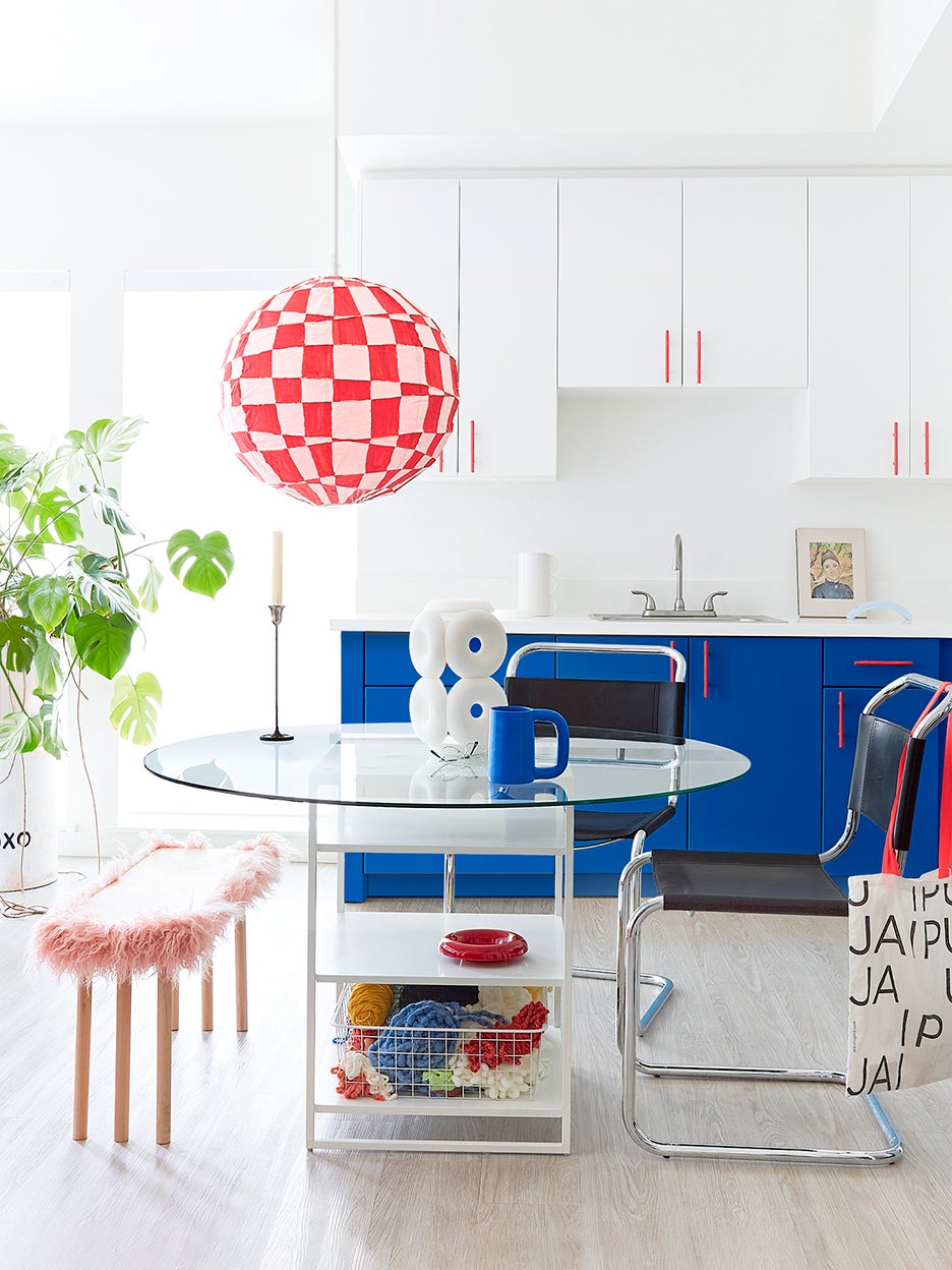 Rental kitchen with blue cabinets and checkered light