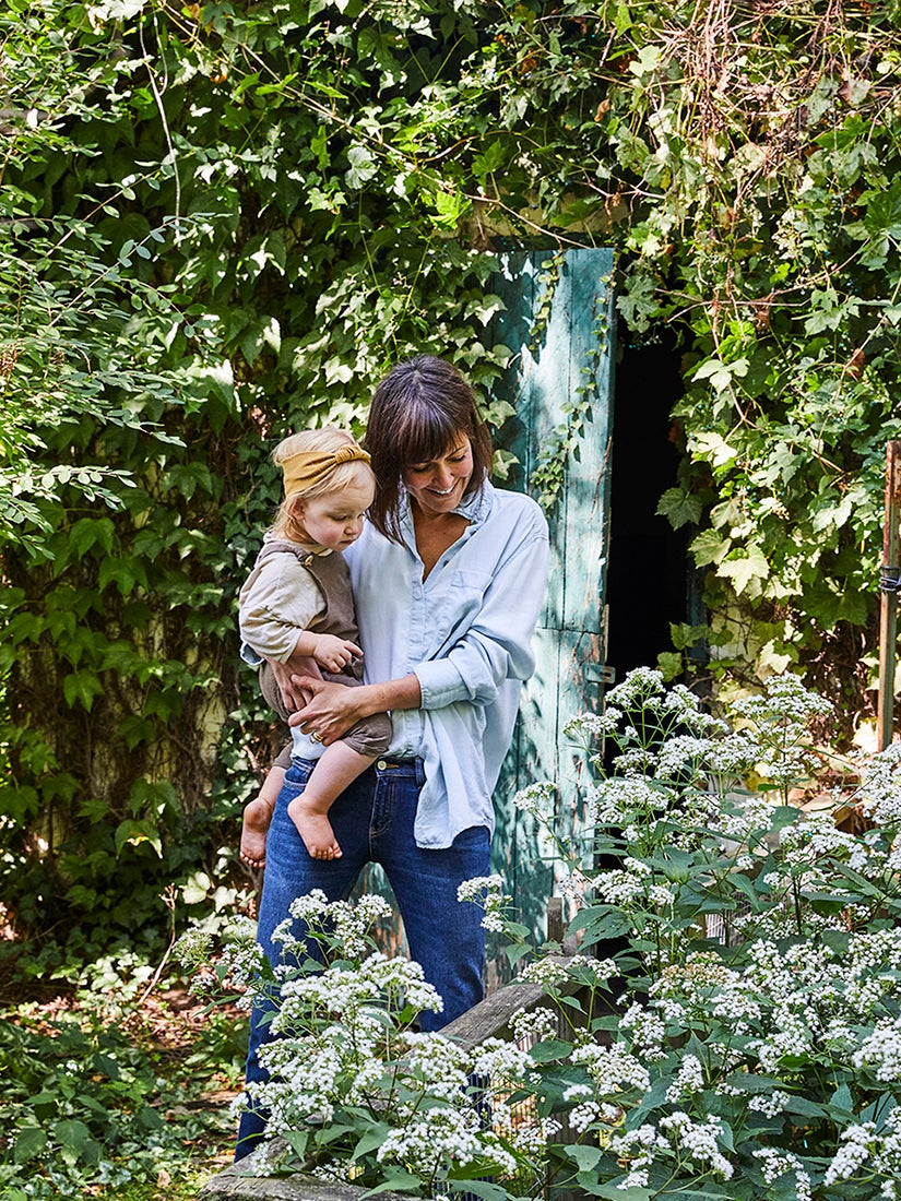 Leanne Ford in her garden with daughter