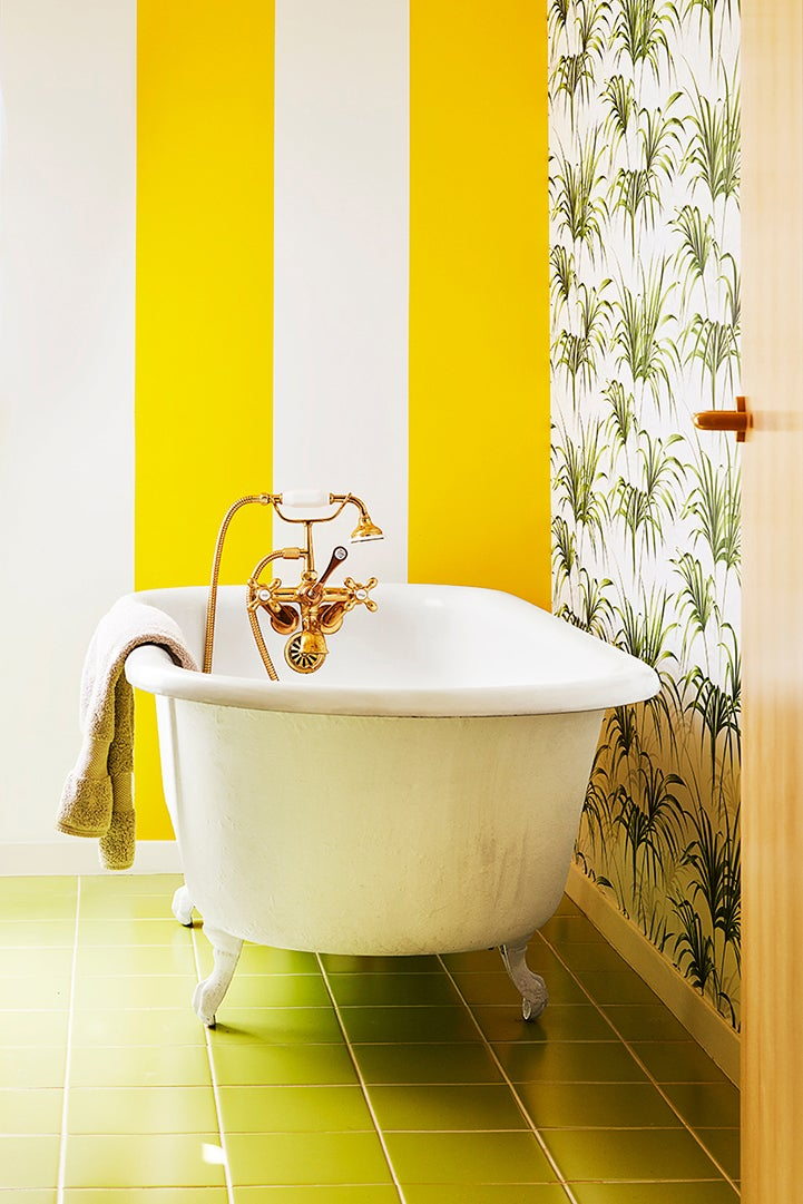 yellow and white striped bathroom