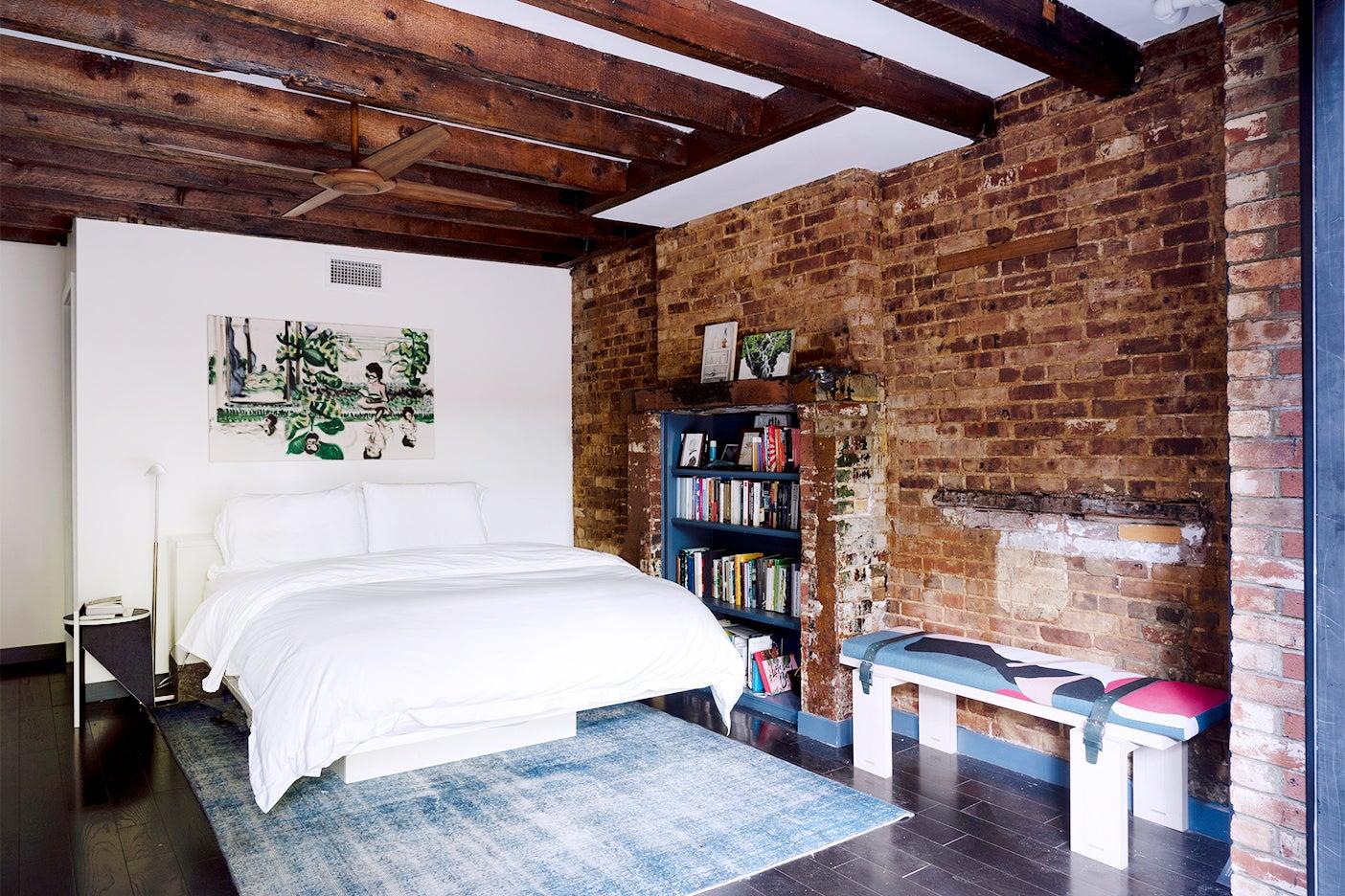 Bedroom with brick walls