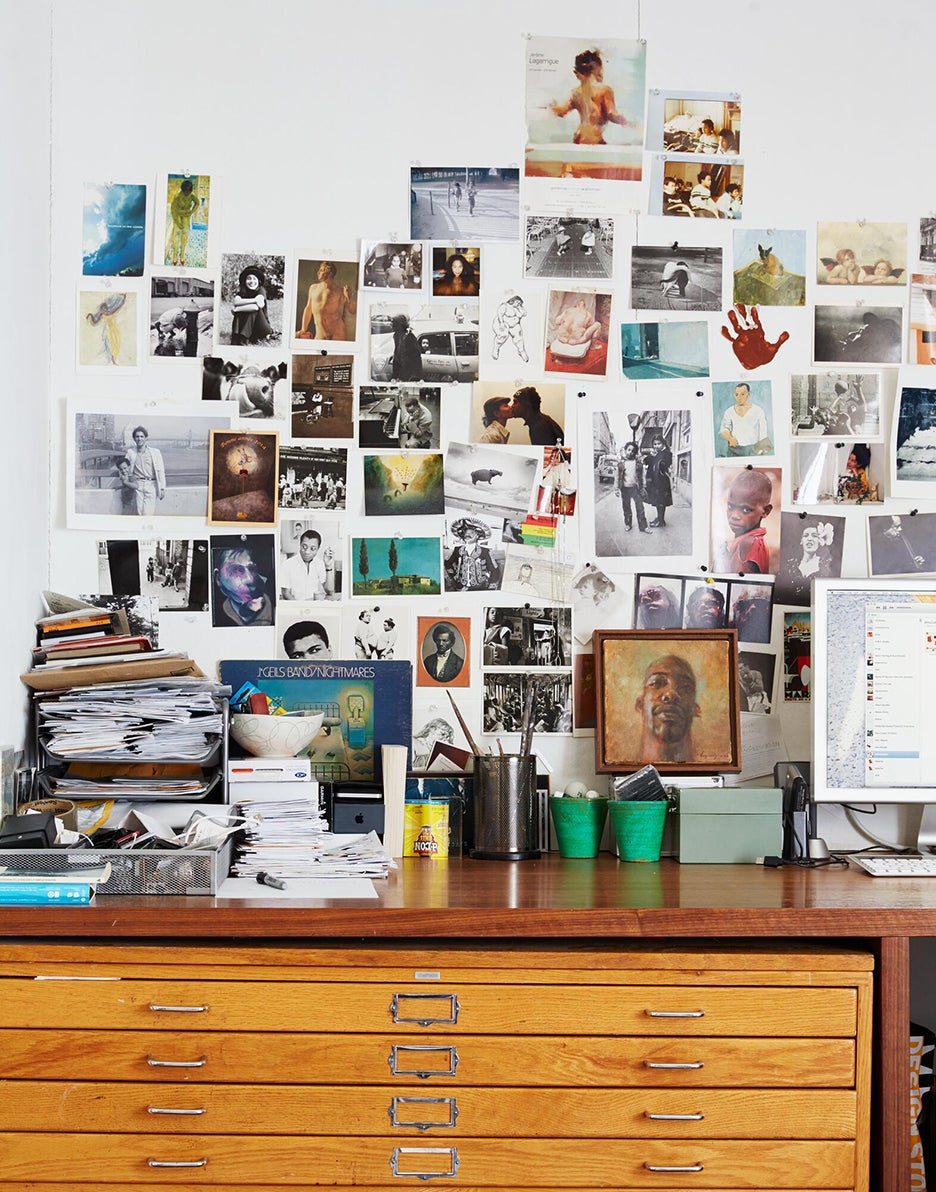Collage wall above a desk
