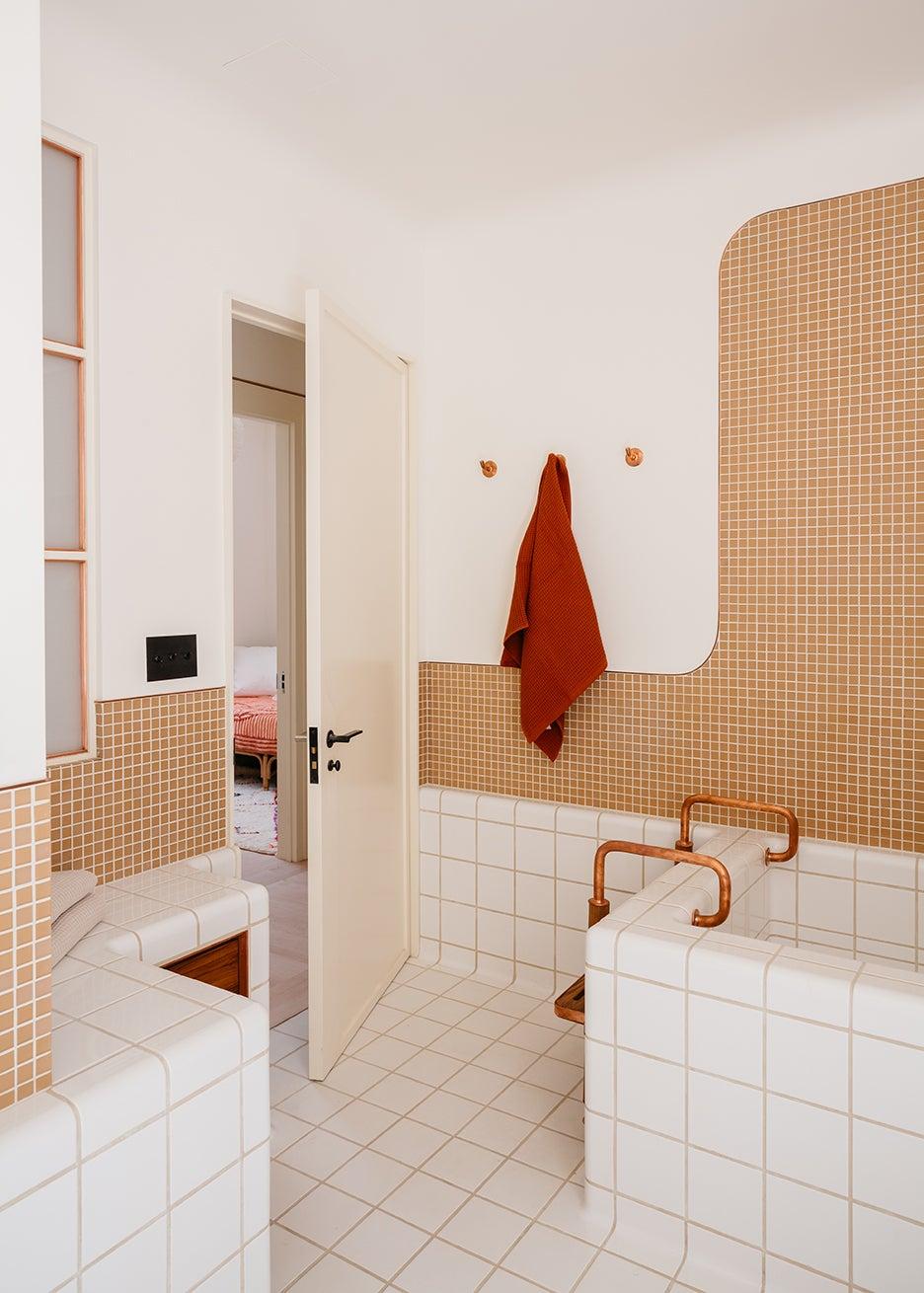 white and orange tiled bathroom