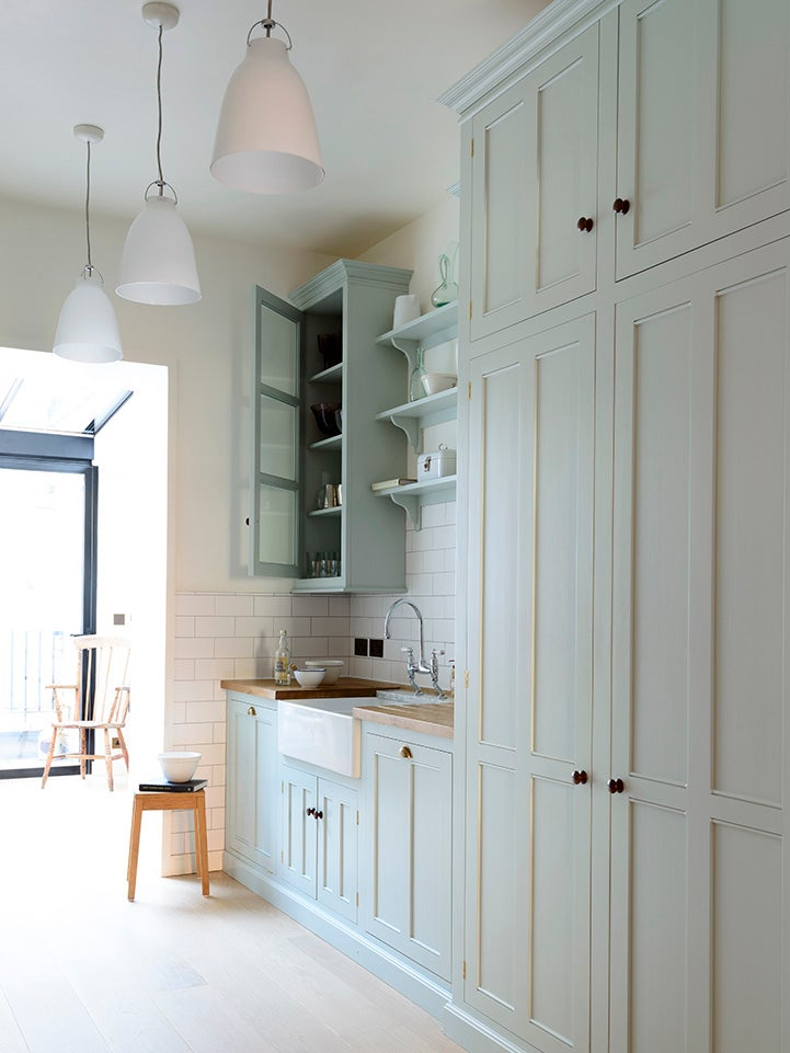 green cabinets with doors open