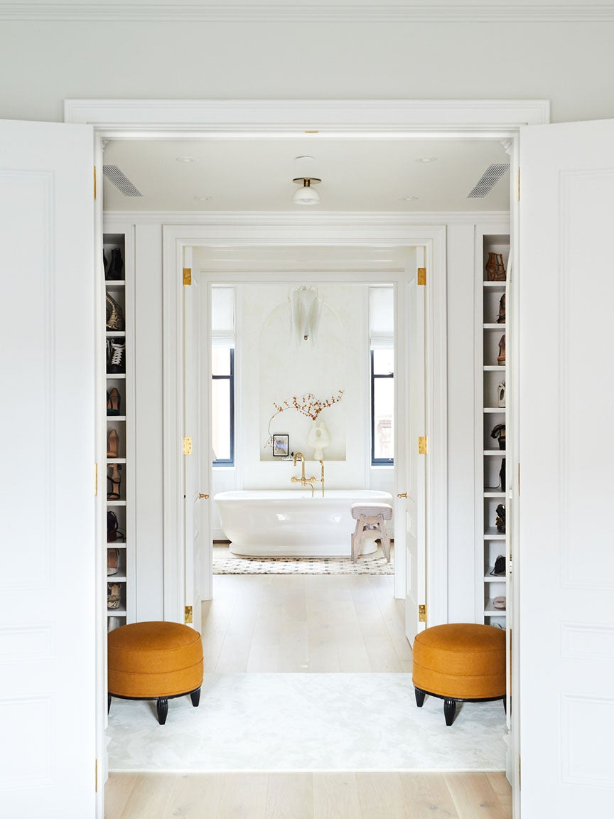 White bathroom at the end of the hallway