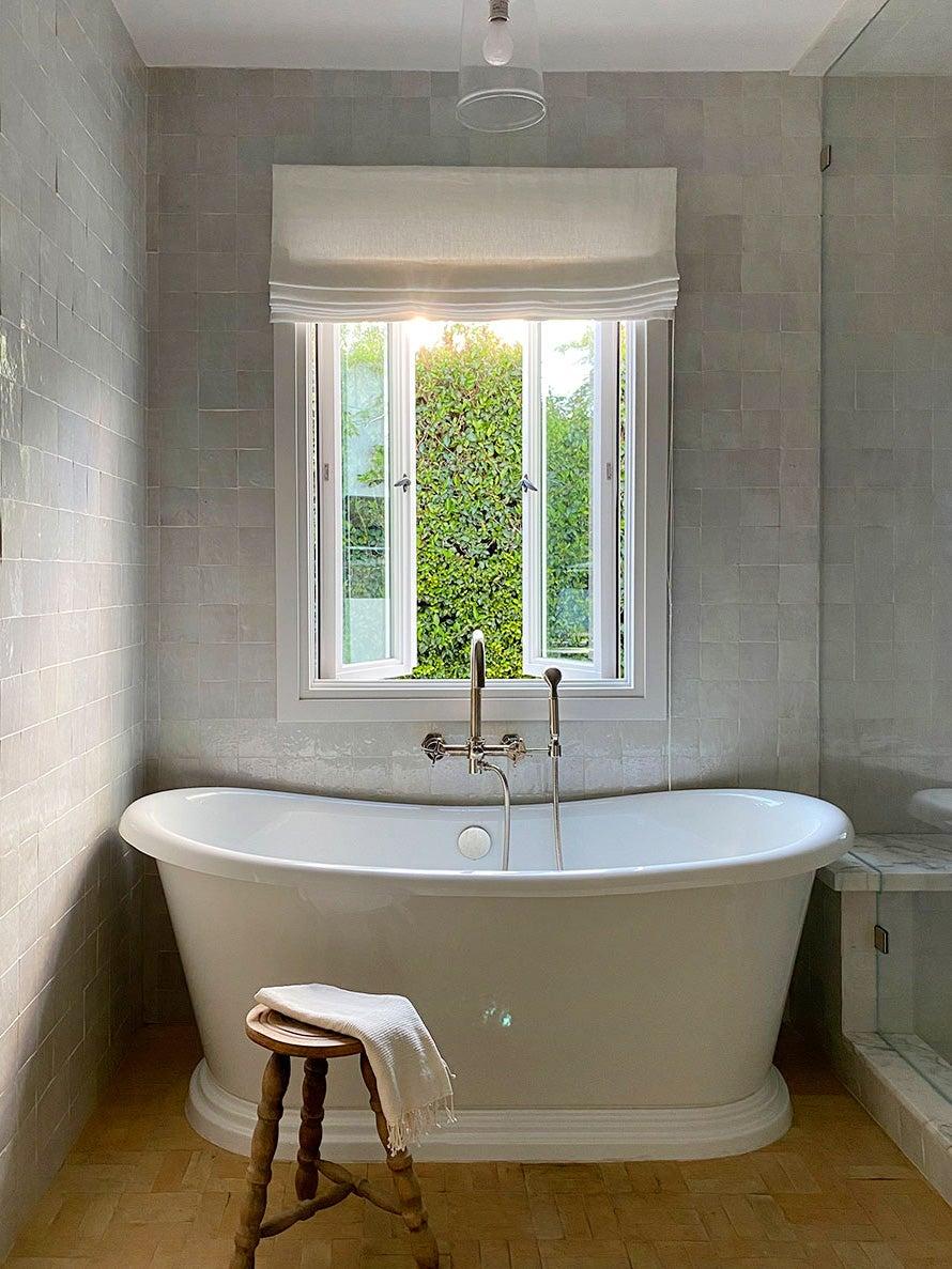gray bathroom with little winodw