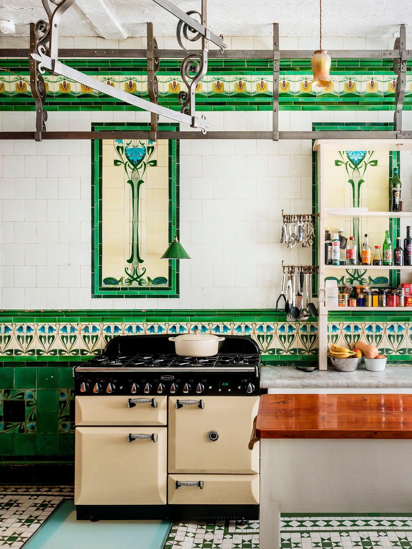 green tiled kitchen