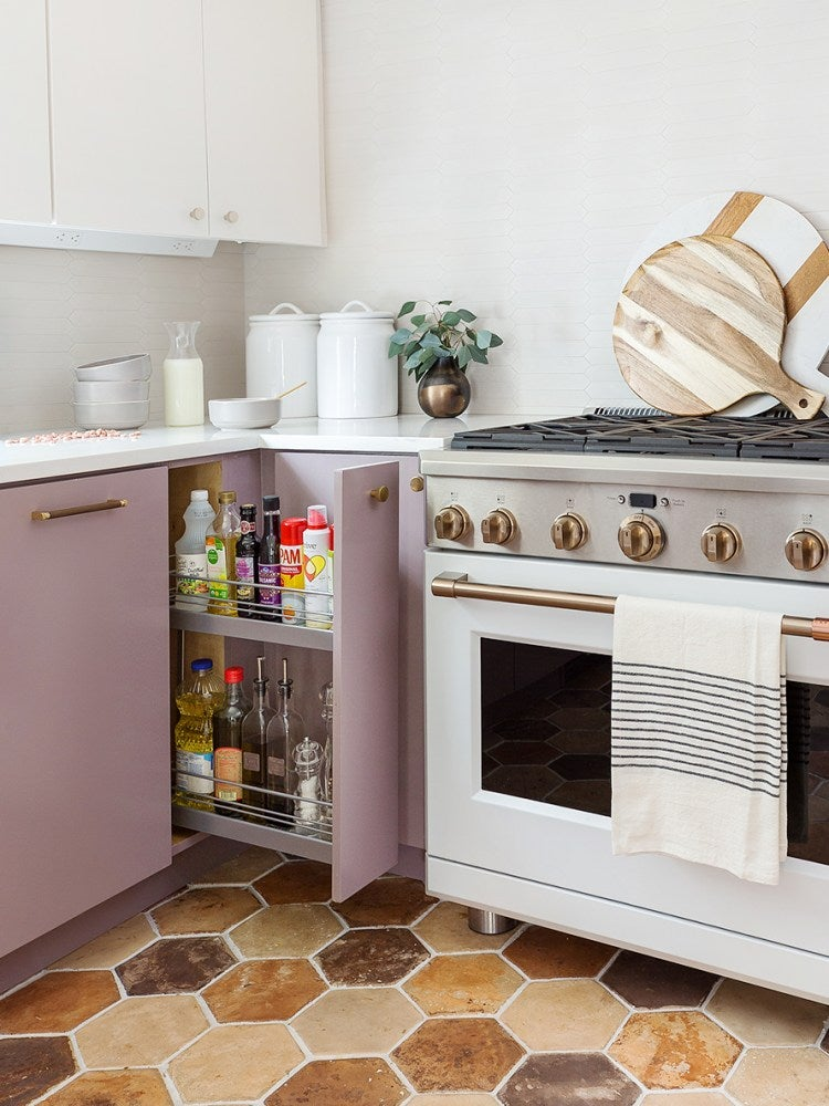 Small kitchen with sliding cabinet door.