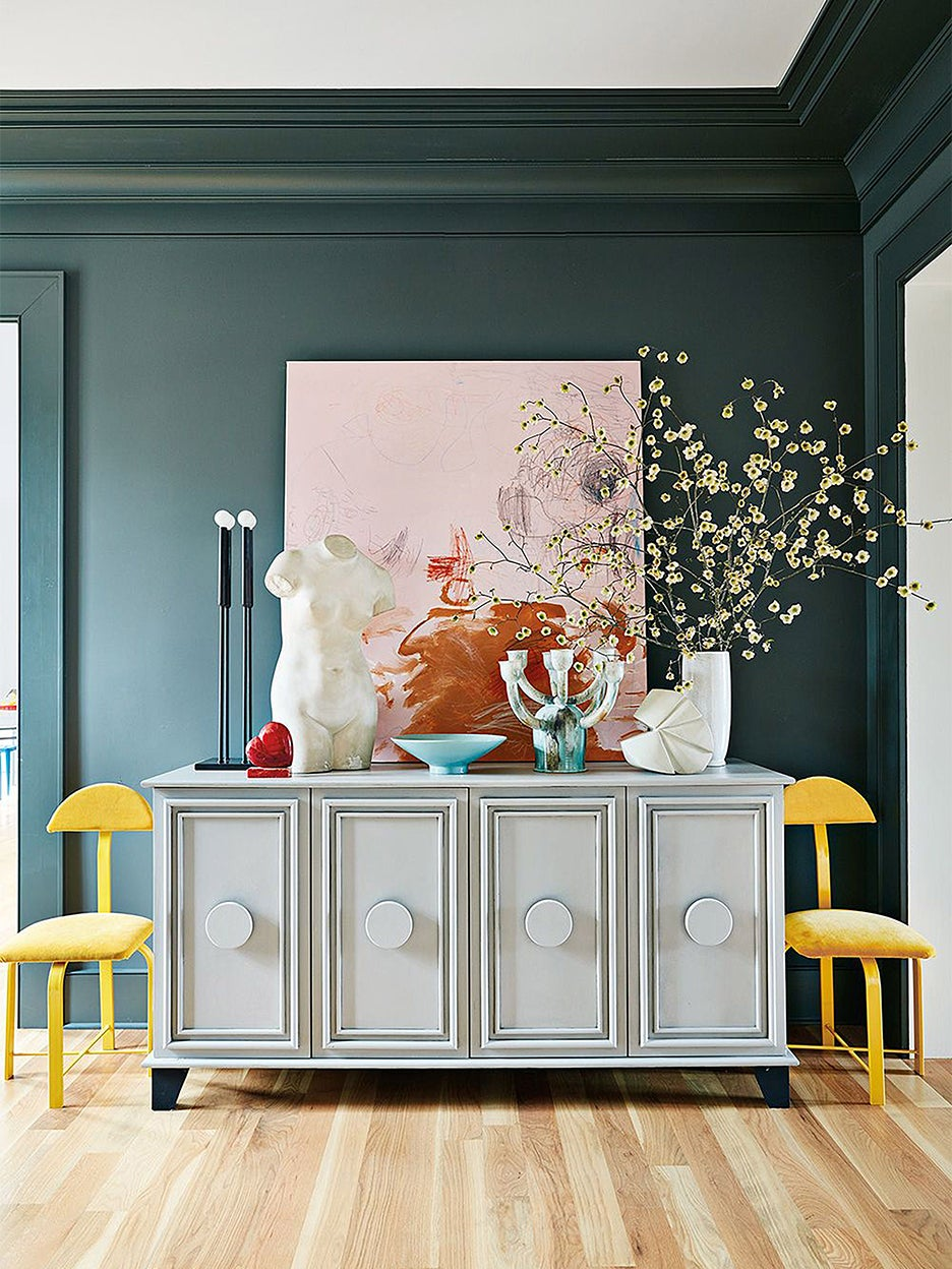 green entryway with gray console