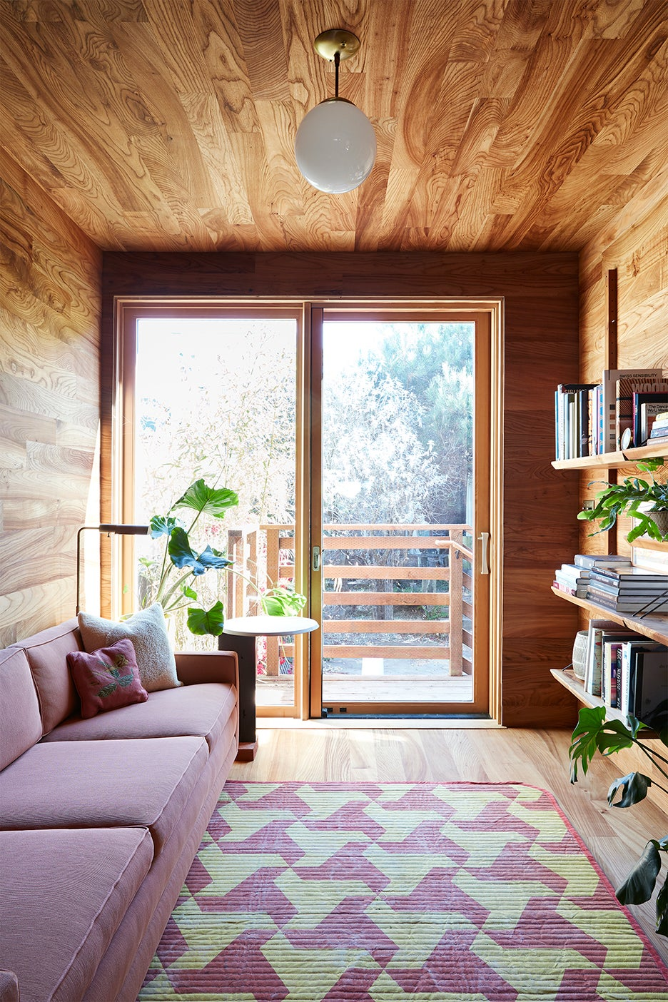 Cozy room with wood paneling on ceiling and walls