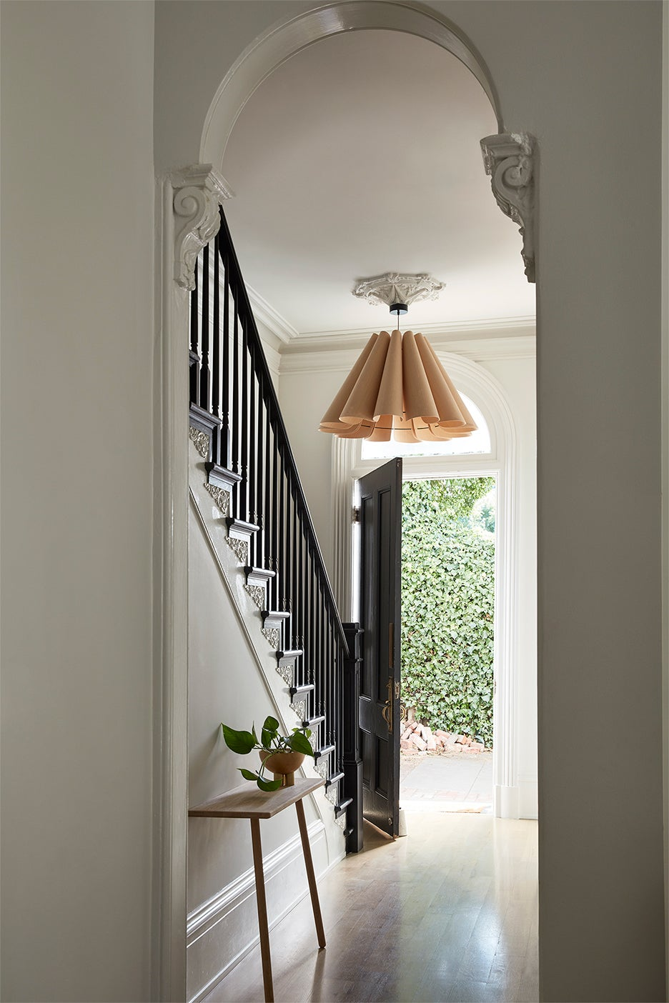 Statement lighting fixture in a entryway