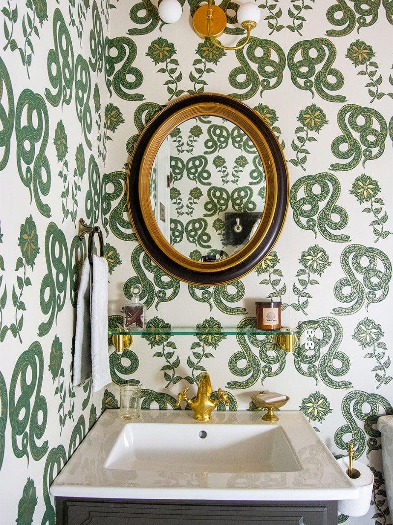 Snake wallpaper in a modern bathroom