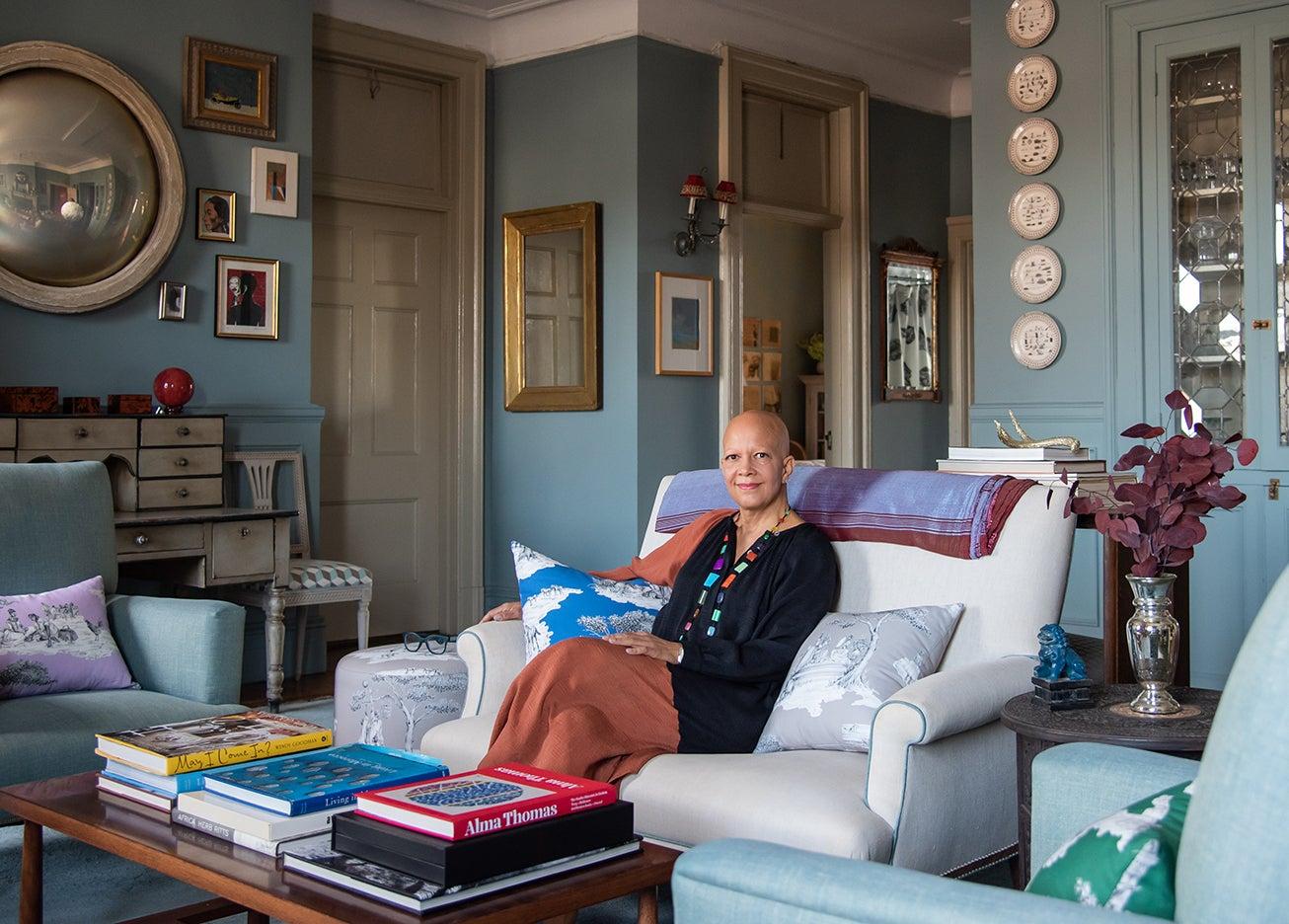 Sheila Bridges sitting on sofa