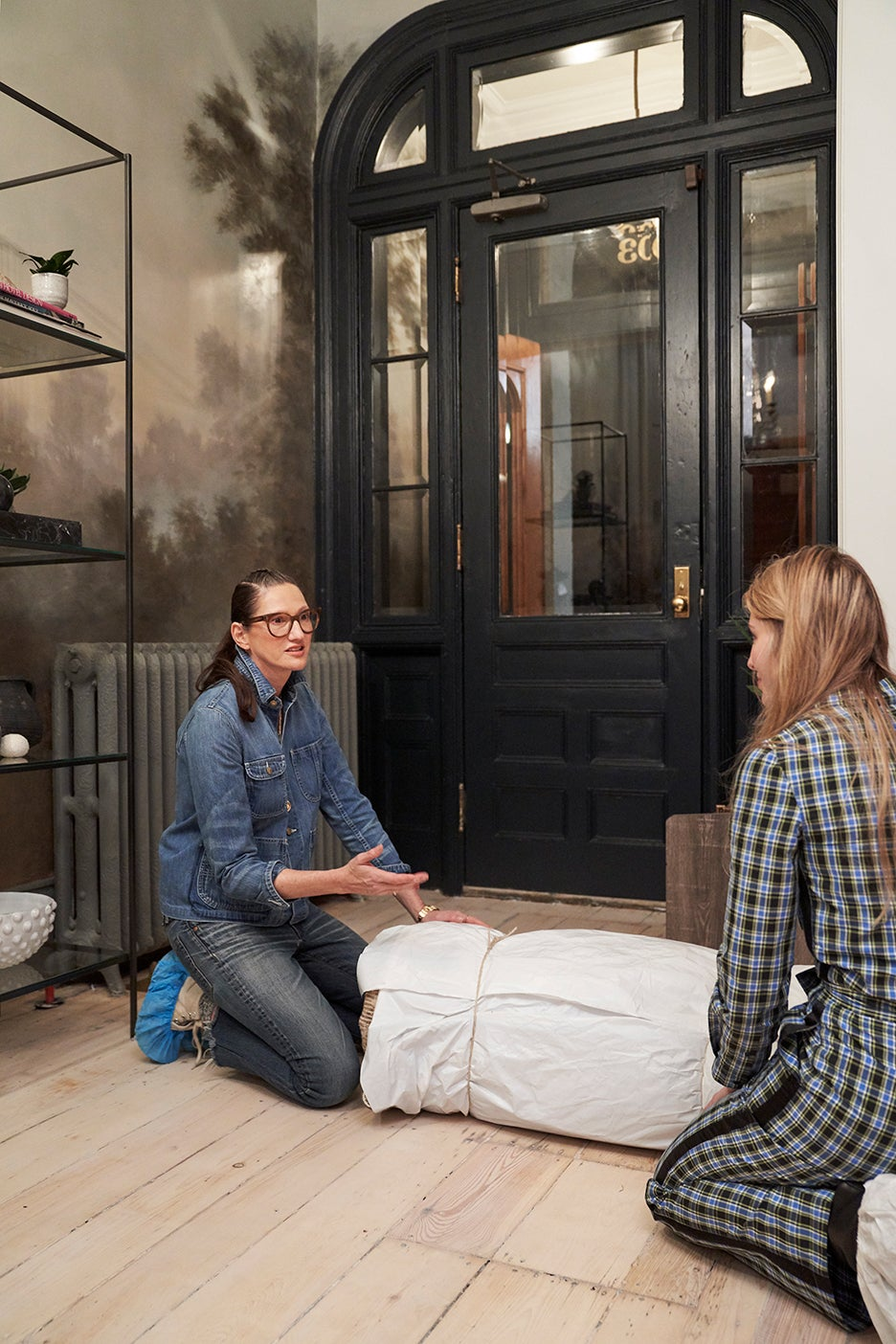 Jenna Lyons rolling out a rug