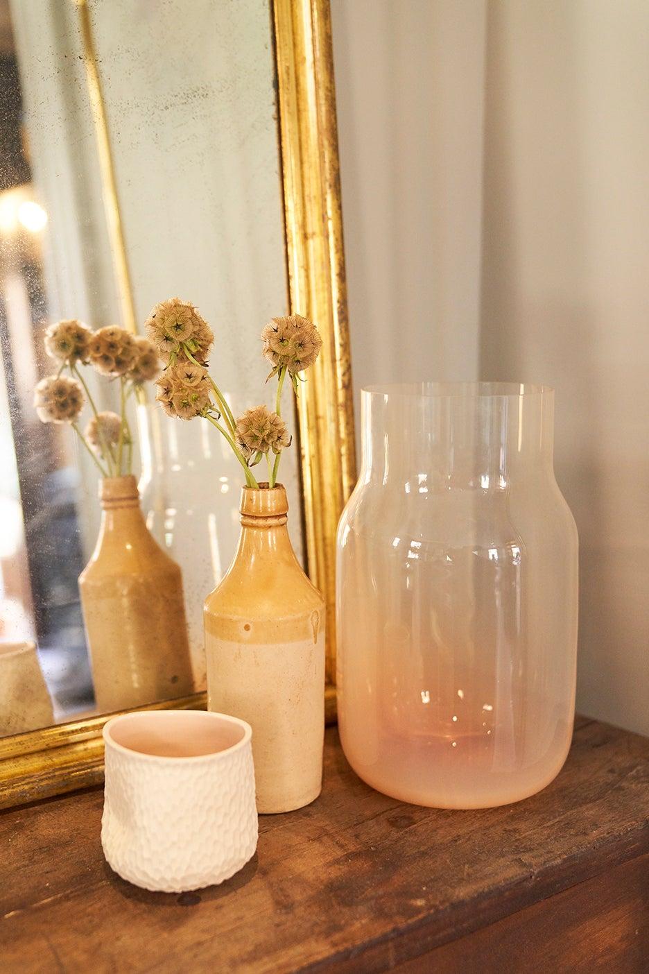 Monochromatic vases styled by Jenna Lyons