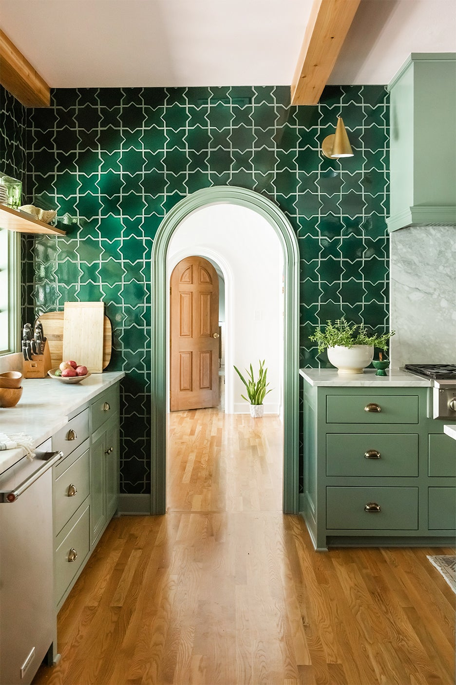 arch doorway leading out of kitchen