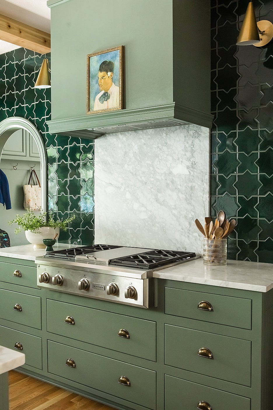 range with marble backsplash