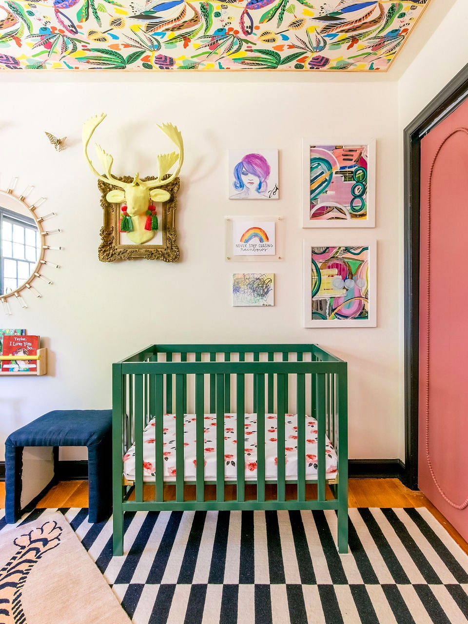 Nursery with green crib and pink closet
