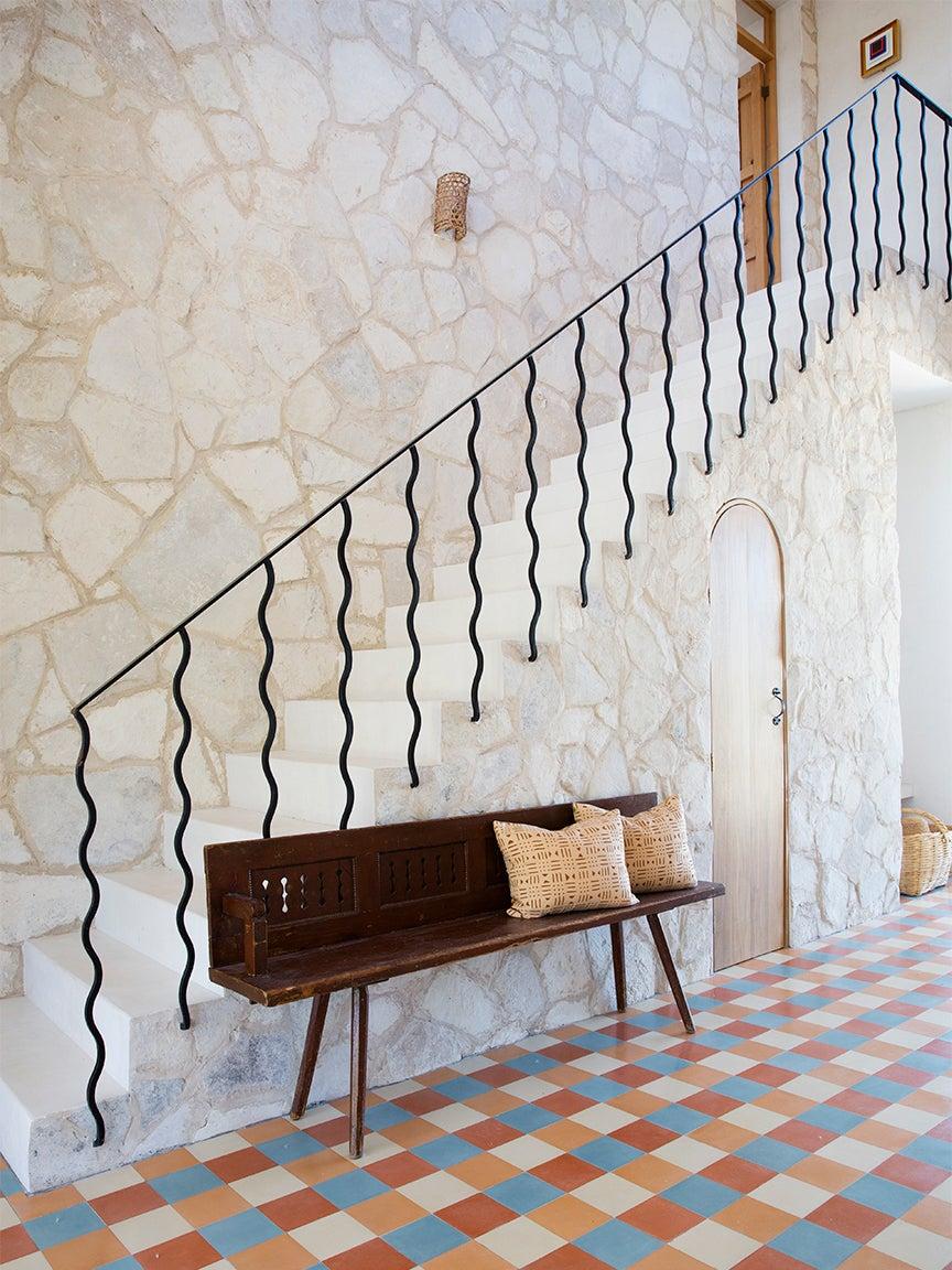 stone stairway with wavy railing