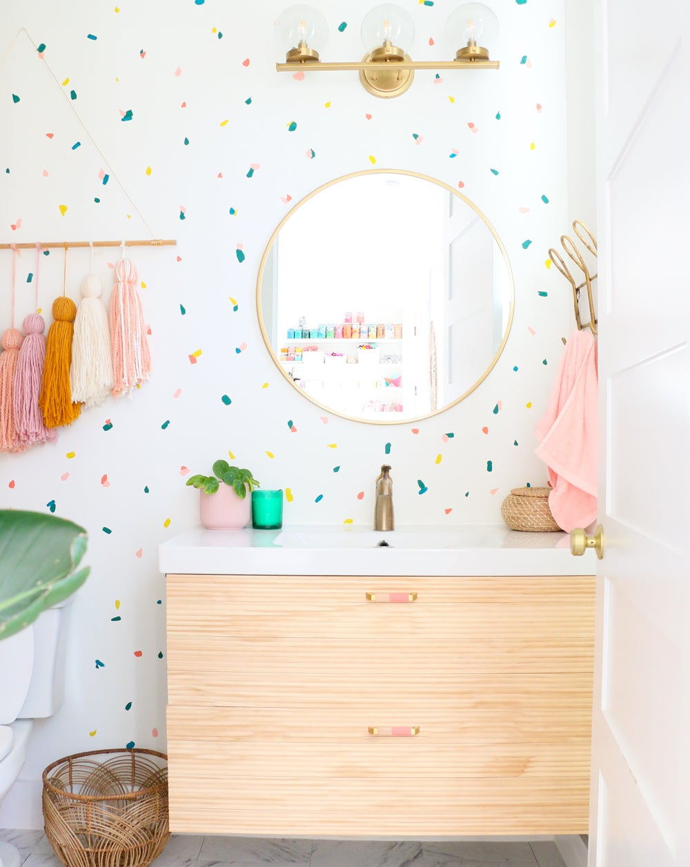 fun bathroom with polka dot wallpaper