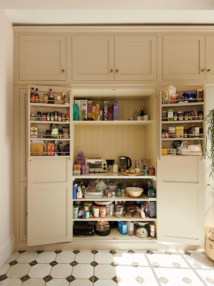 beige pantry with doors open
