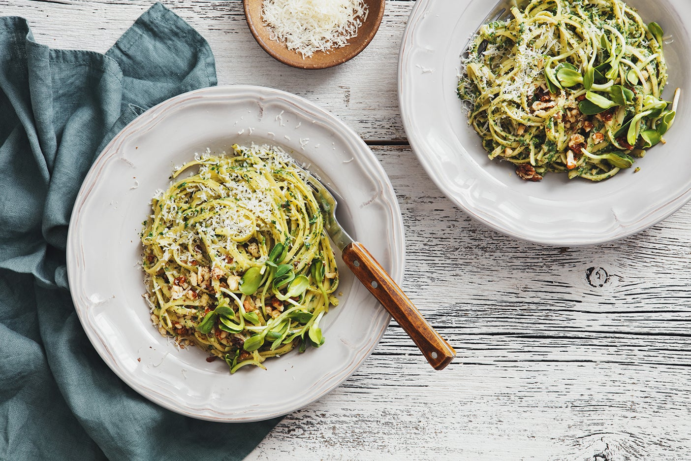 Spaghetti with vegetables, spinach and parmesan