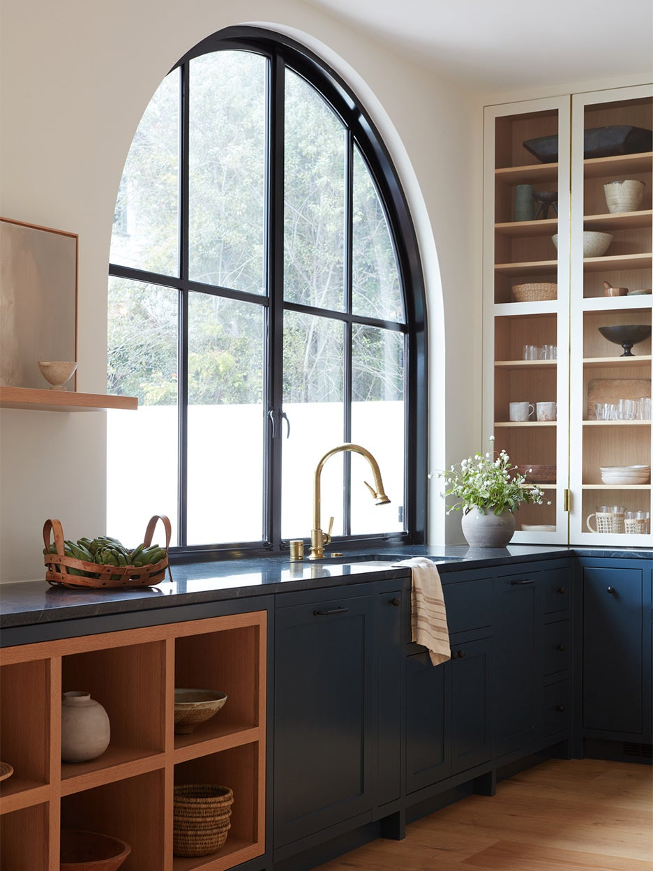 Double-height glass cabinets were nonnegotiable in this L.A. family's home