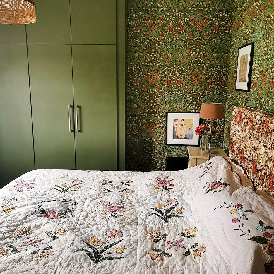 Green floral wallpaper in bedroom