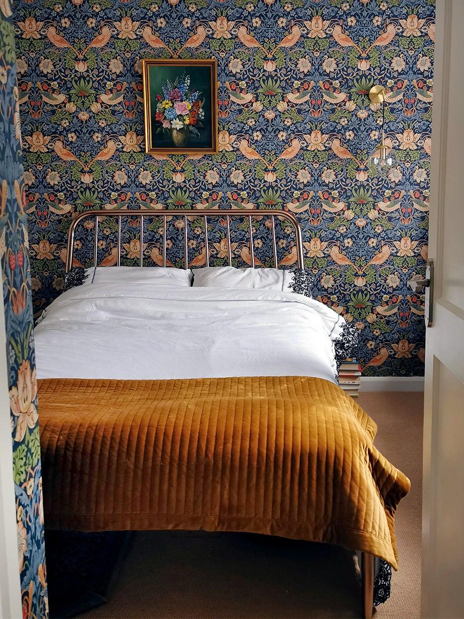 Blue floral wallpaper in bedroom