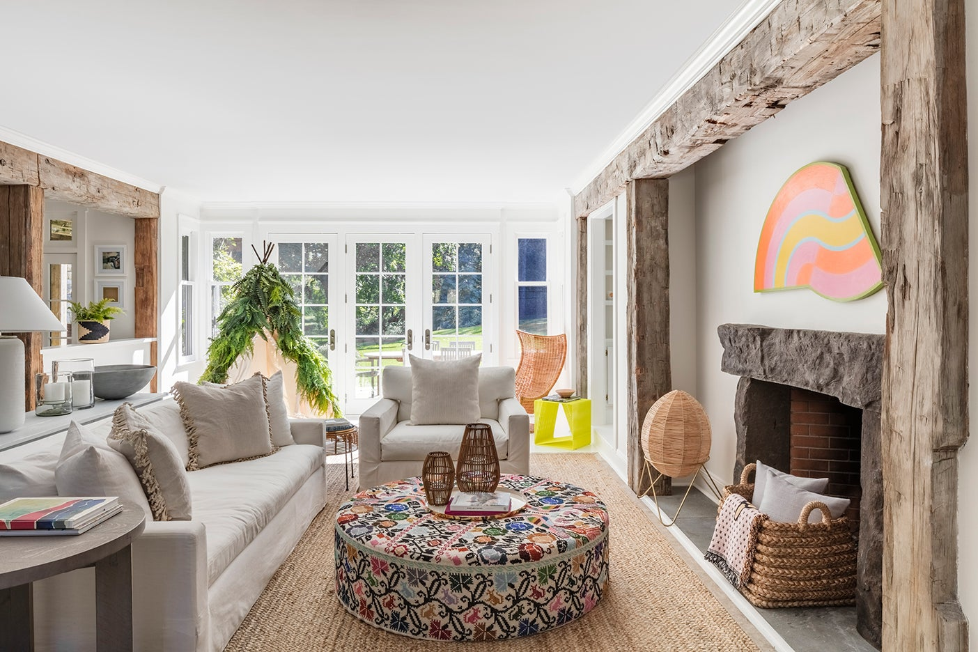 White living room with neon art