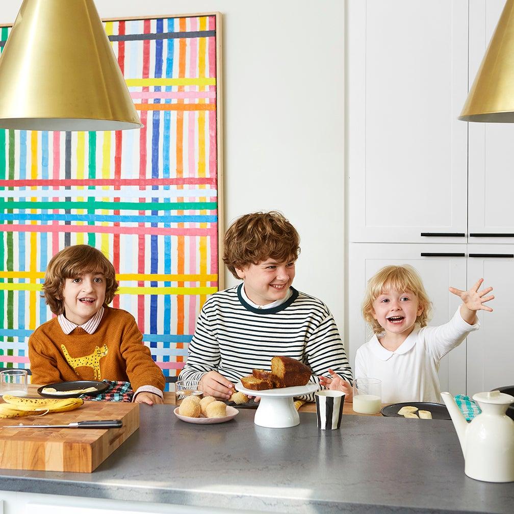 three kids at a kitchen counter