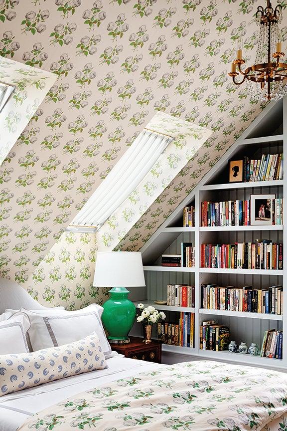 small bedroom and bookshelf