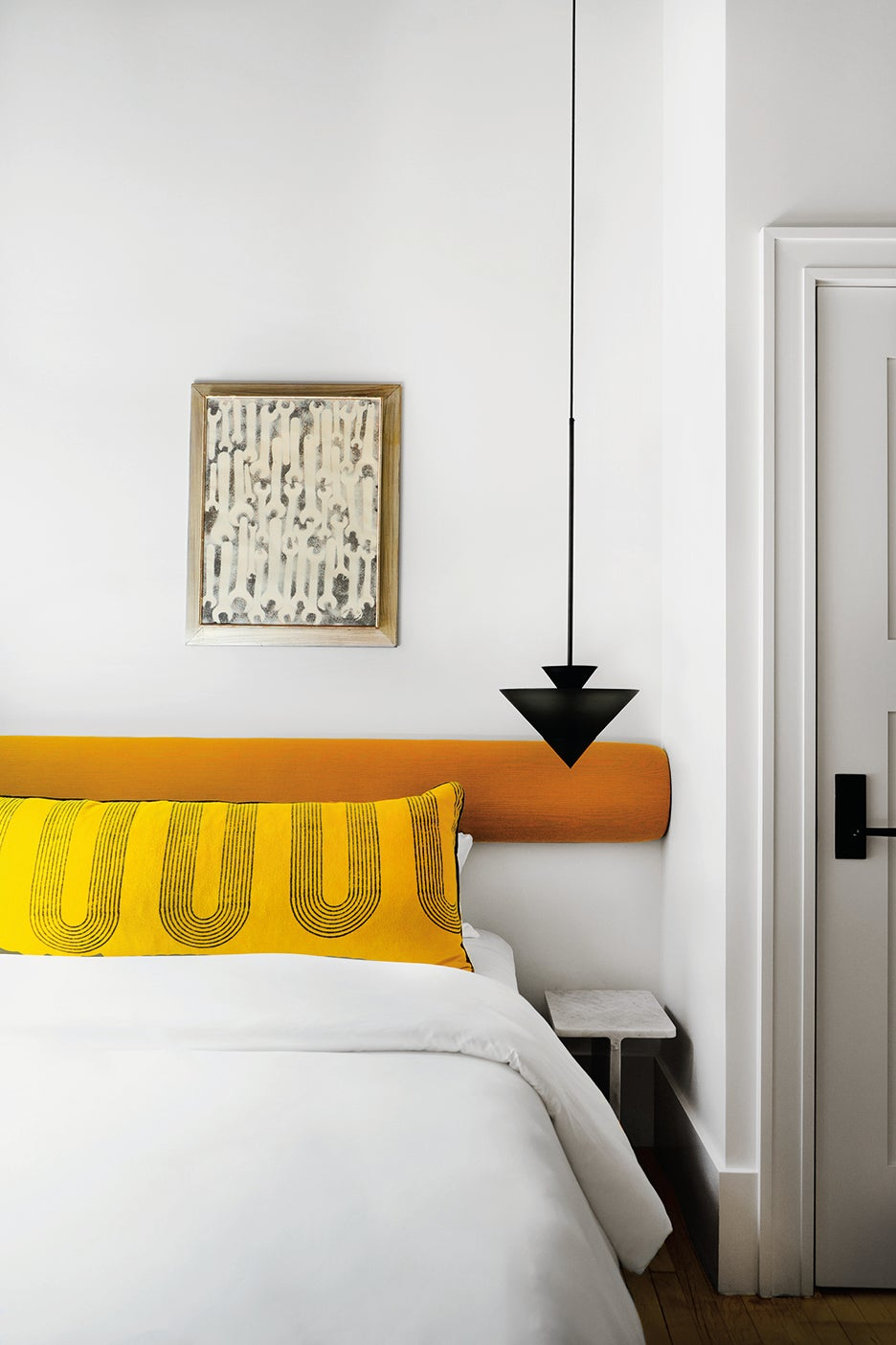 bed with yellow pillow