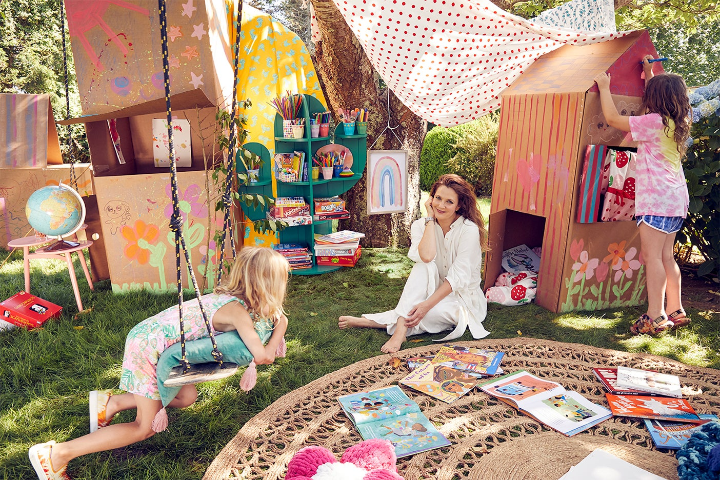 Drew Barrymore surrounded by forts outside her home.