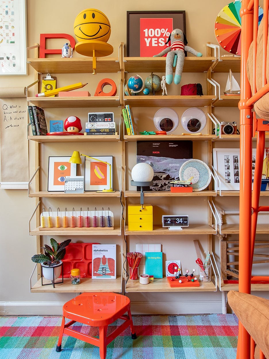 Wood shelving with colorful kids' toys.
